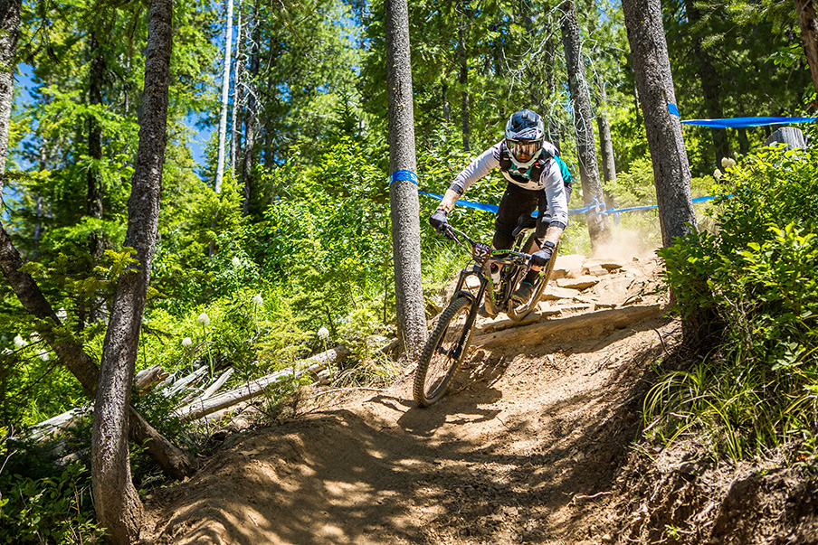 Biker racing down the mountain during the North American Enduro Cup.