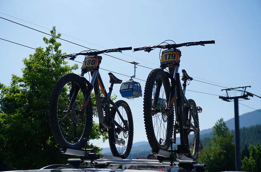Bikes on top of a car with a gondola in the background